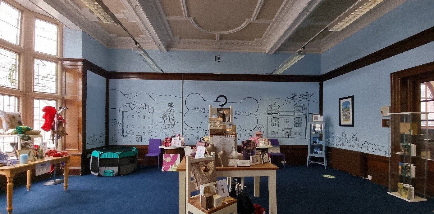 The shop area in our Alloa community space, filled with goods for sale.