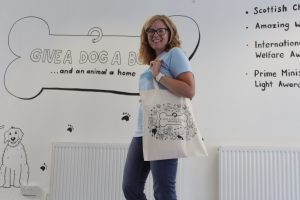 Natural coloured tote bag with illustration on one side. The illustrations is by LAW Illustrates and shows our logo, surrounded by drawings of some of our supporters dogs.